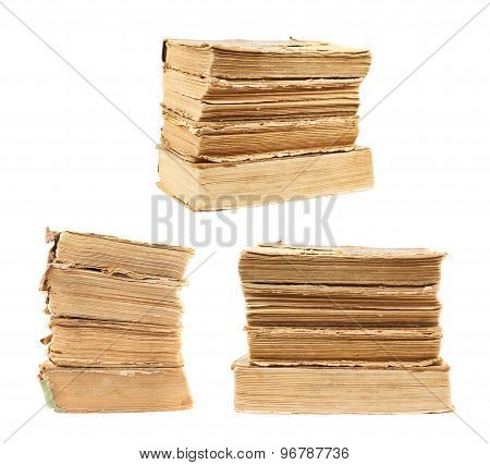 Stack of old decrepit books isolated