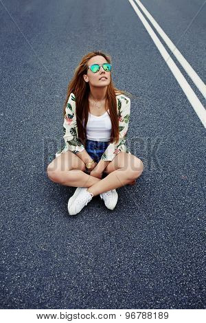 Trendy fashion model posing with skate board wearing colorful sunglases copy space area for content