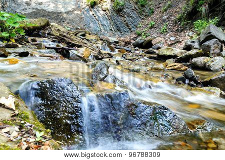 A Mountain Stream Flowing Between Stones