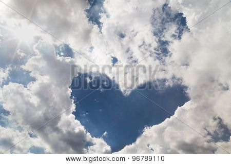 Heart shaped blue sky from cloud formation