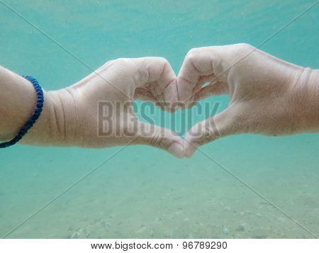 Hand Heart Shape Underwater