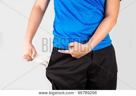Teenager pointing to his empty pocket of his pants