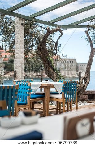 Interior Of A Summer Terrace Of Restaurant. Sea View On Islet Saint Stephen In Montenegro