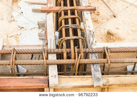Close up on foundation beam being constructed at construction site