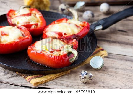 Red pepper stuffed with pasta and cheese on old wooden table
