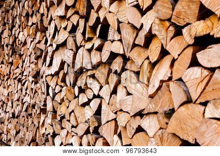 Chopped Wooden Logs Stacked In The Woodpile