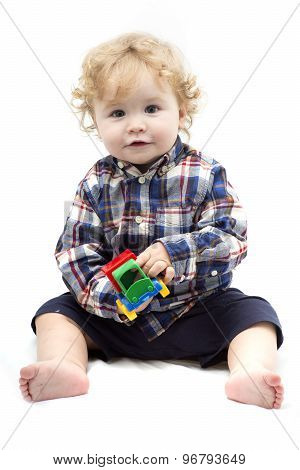 Little Baby Boy Playing With Colorful Toy