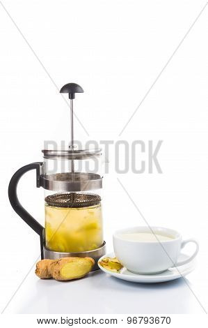 Stimulating hot ginger tea in cup and filter jar