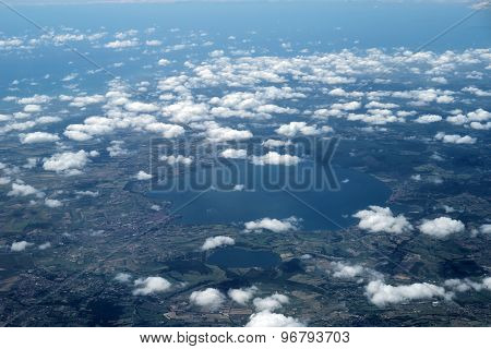 Outer View On Land And Clouds