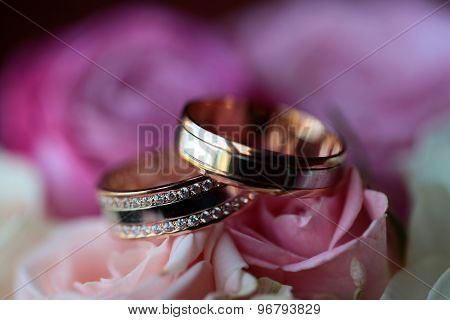 Two Wedding Rings With Flowers