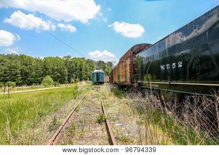 Steel Rails And Abandoned Trains