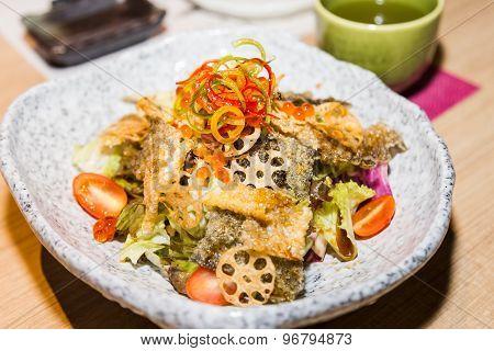 Japanese shake kawa salad with dried salmon skin and lotus roots