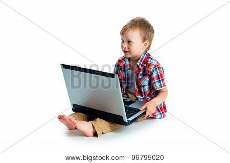 Little Blue-eyed Boy With A Laptop On A White Background
