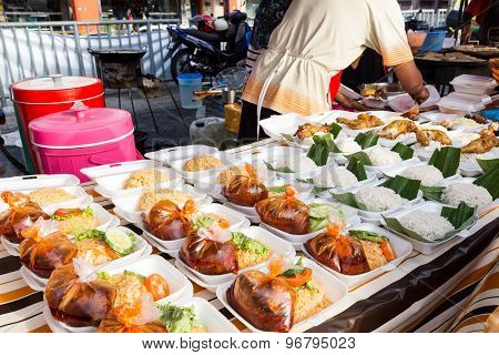 Vendor selling cuisine at street bazaar in Malaysia catered for iftar during Muslim fasting month of