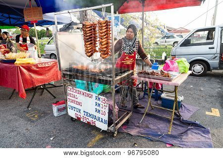 KUALA LUMPUR, MALAYSIA, JUNE 25, 2015: Vendors selling cuisine at street bazaar catered for iftar or breaking fast during the Muslim fasting month of Ramadan. Fasting for 2016 scheduled to fall on June 6.