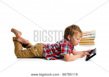 Small Boy With Tablet Computer And Books