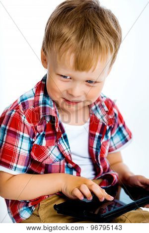 Smiling Boy With A Tablet Computer