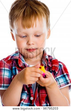 Little Boy With A Toy