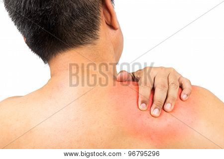 Matured man suffering shoulder pain embraces area with hand