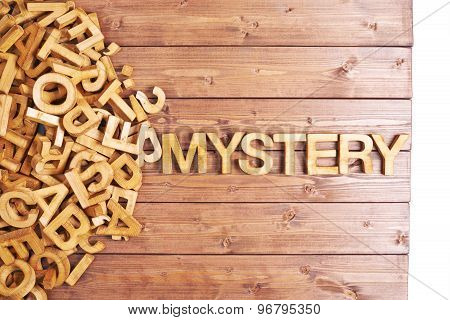 Word mystery made with wooden letters