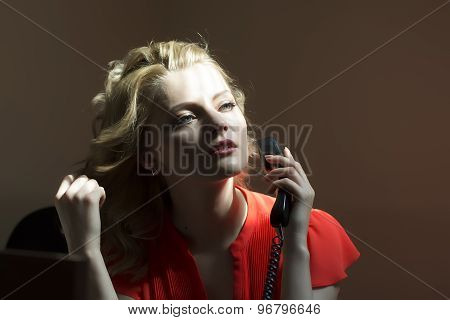 Working Female Secretary With Phone