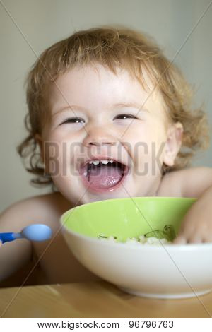 Portrait Of Funny Boy Eating