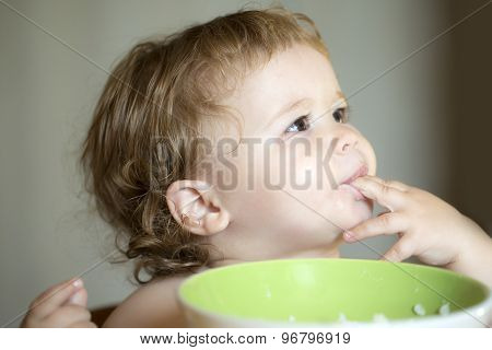 Portrait Of Funny Baby Boy Eating