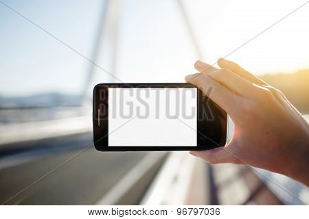 Female hand holding smartphone with blank copy space area for your text message or content