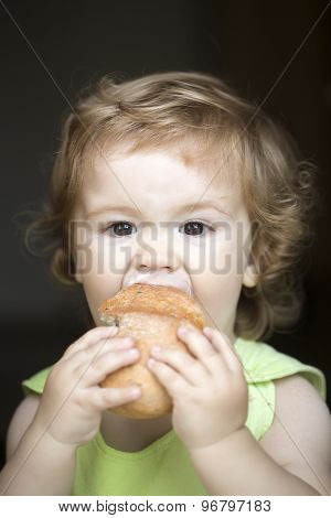 Hungry Small Boy With Bread Roll