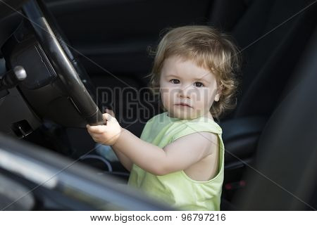 Little Male Driver In Car