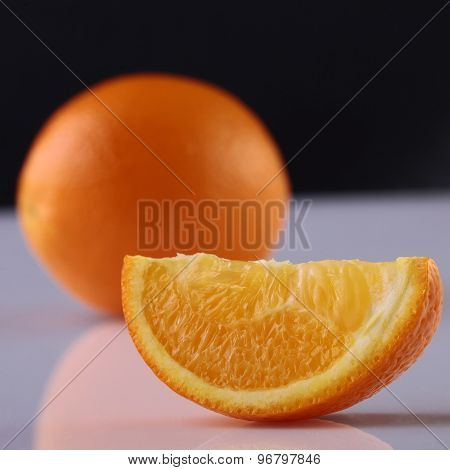 Orange Lobule And Whole Fruit In Studio