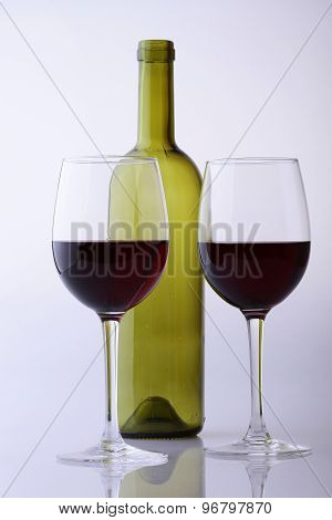 Empty Bottle And Glasses With Wine