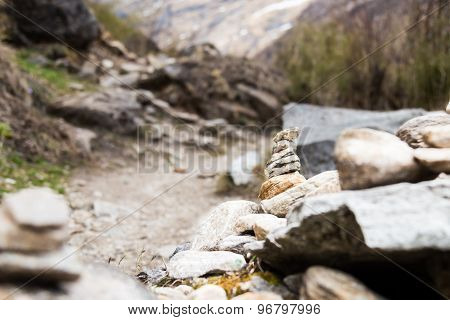 Zen rock arrangement that mimic the Stupa along hiking trail to the mountains of Annapurna, Nepal