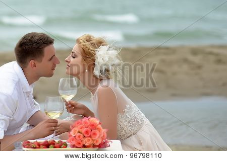 Wedding Couple Drinking Wine On Beach