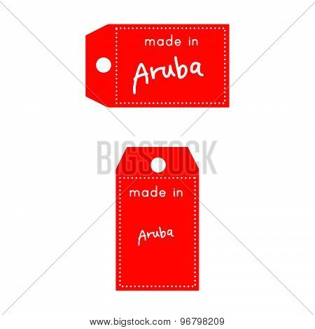 Red Price Tag Or Label With White Word Made In Aruba Isolated On White Background.