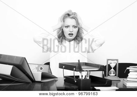 Upset Woman At Office Table