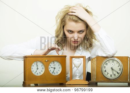 Serious Woman With Sand Glass And Clocks