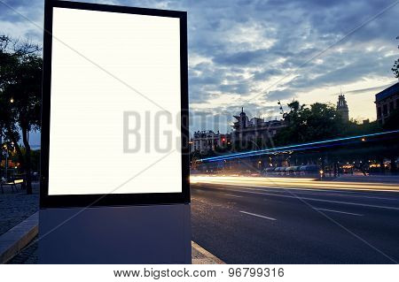 Illuminated blank billboard with copy space for your text message or content in metropolitan city