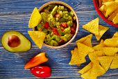 foto of nachos  - Guacamole with avocado tomatoes and nachos mexican food - JPG