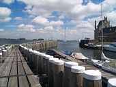 stock photo of veer  - Old picturesque Dutch historical port in Veere Zeeland - JPG