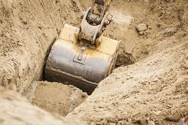 pic of excavator  - Working Excavator Tractor Digging A Trench - JPG