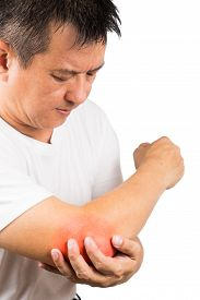 stock photo of elbow  - Matured man suffering from sore and painful elbow embraces elbow - JPG
