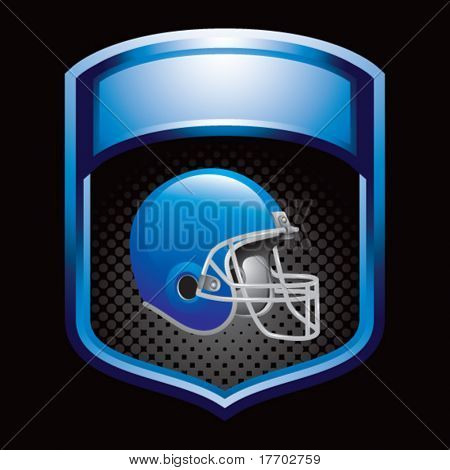 colored football helmet on blue display