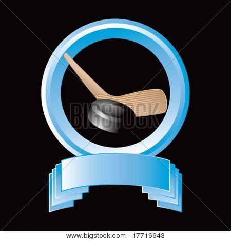 hockey stick and puck round blue display
