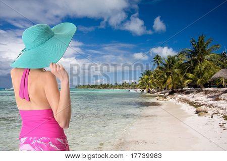 Lady wearing a sun hat on a Caribbean beach