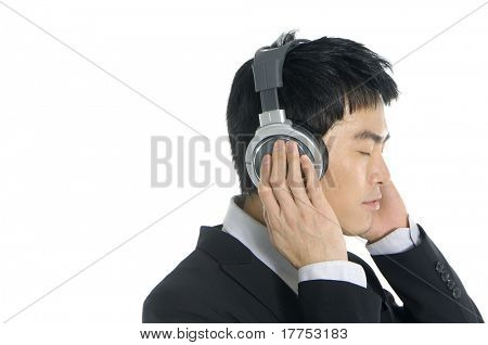 Business man listening to music, isolated in white background