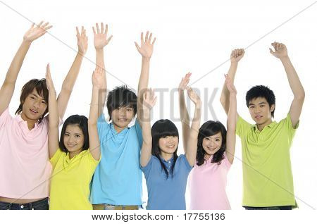 young students laughing together with arms raised in success
