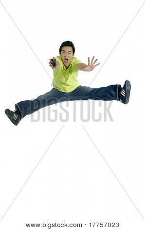 One very happy energetic man jumping into the air.