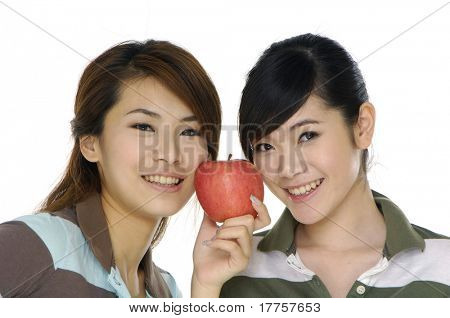 Two beautiful girls with apple