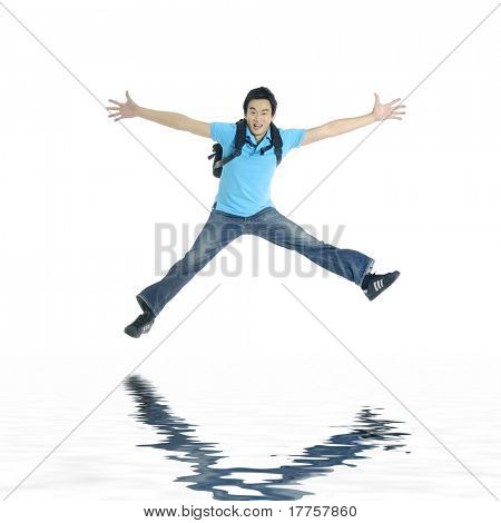 Reflection for excited young man jumping in mid-air cheering and celebrating his success